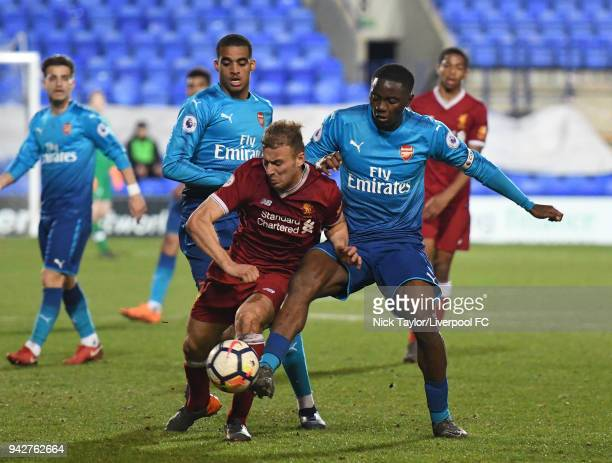 Herbie Kane of Liverpool and Josh Da Silva and Yassin Fortune of Arsenal in action during the Liverpool U23 v Arsenal U23 game at Prenton Park on...