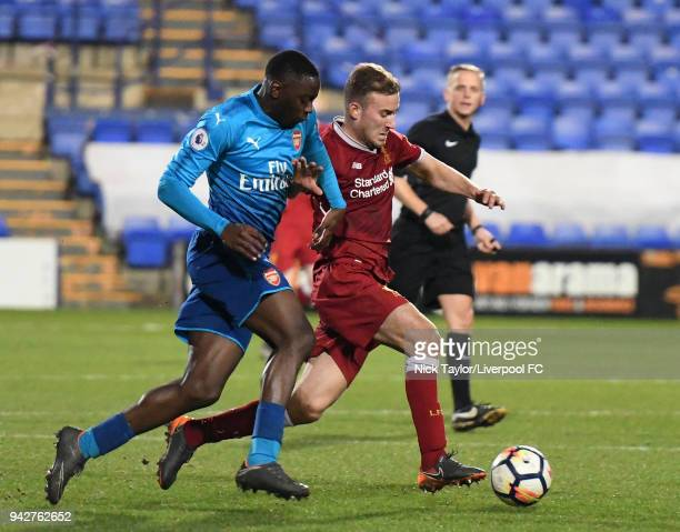 Herbie Kane of Liverpool and Josh Da Silva of Arsenal in action during the Liverpool U23 v Arsenal U23 game at Prenton Park on April 6 2018 in...