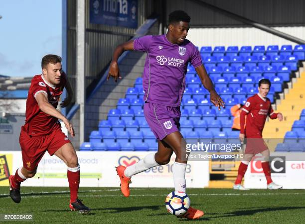 Herbie Kane of Liverpool and Tyreeq Bakinson of Bristol City in action during the U23 Premier League Cup between Liverpool and Bristol City at The...