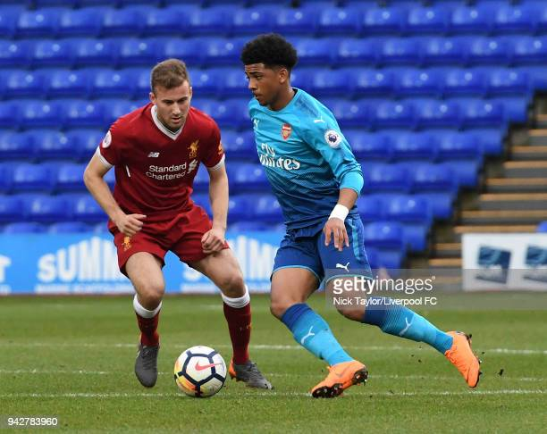 Herbie Kane of Liverpool and Xavier Amaechi of Arsenal in action during the Liverpool U23 v Arsenal U23 game at Prenton Park on April 6 2018 in...