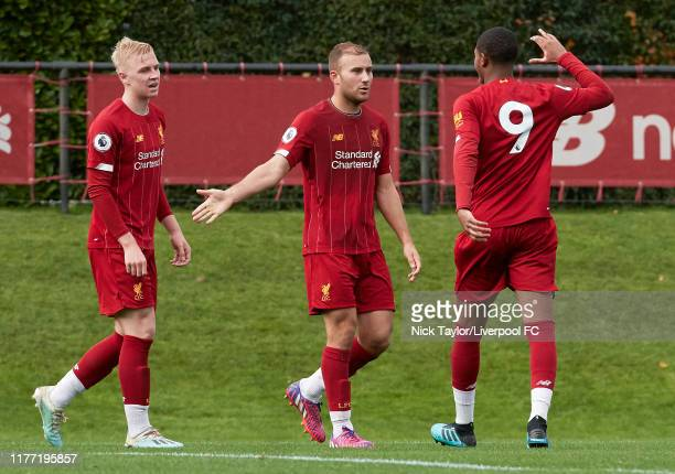 Herbie Kane of Liverpool celebrates scoring Liverpool's second goal with Rhian Brewster and Luis Longstaff during the PL2 game at The Kirkby Academy...