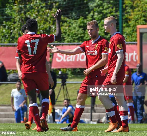 Herbie Kane of Liverpool celebrates scoring Liverpool's third goal with Glen McAuley and Bobby Adekanye at The Kirkby Academy on May 14 2018 in...