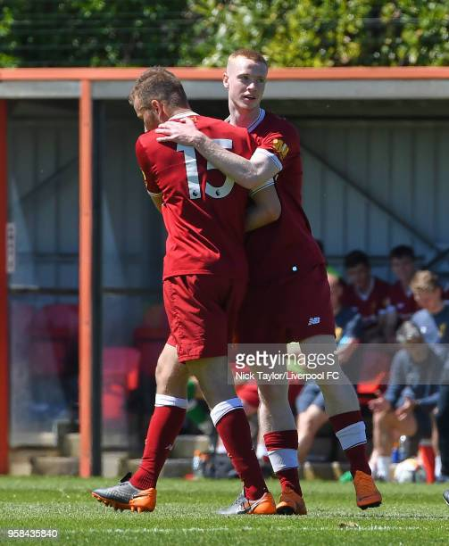 Herbie Kane of Liverpool celebrates scoring Liverpool's third goal with Glen McAuley at The Kirkby Academy on May 14 2018 in Kirkby England