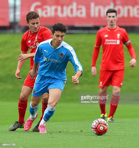 Herbie Kane of Liverpool competes with Nicu Carnat of Wolverhampton Wanderers during the Barclays U18 Premier League match between Liverpool U18 and...