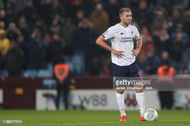 Herbie Kane of Liverpool dejected after Jonathan Kodjia of Aston Villa scores a goal to make it 40 during the Carabao Cup Quarter Final match between...