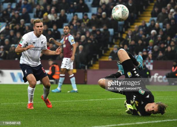 Herbie Kane of Liverpool with Orjan Hyland of Aston Villa During the Carabao Cup Quarter Final match between Aston Villa and Liverpool FC at Villa...