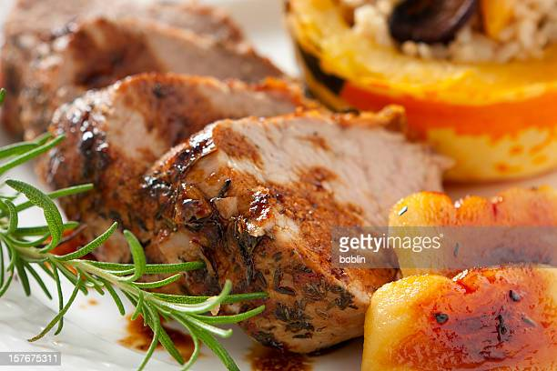 herb-roasted  loin of pork with apples - pork stock pictures, royalty-free photos & images