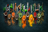 Herbs and spices for cooking on dark background