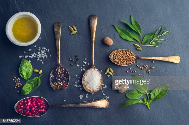 Herbs and spices on slate.