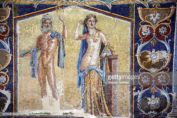 Herculaneum. House of the Mosaic of Neptune and Amphitrite. A small courtyard forming an open-air dining room. One wall is decorated with a mosaic...