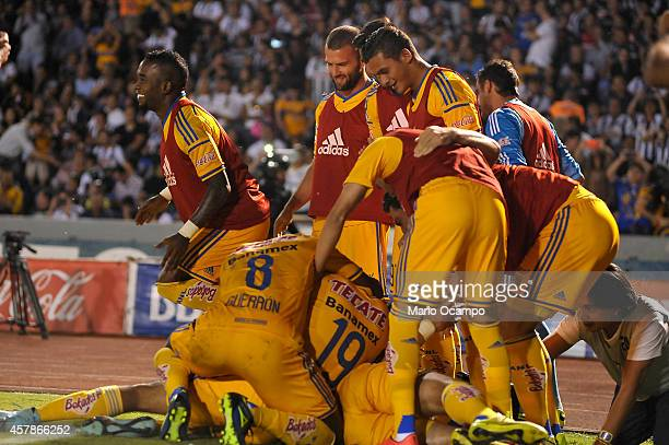 Hercules Gomez of Tigres celebrates with teammates after scoring the second goal of his team during a match between Monterrey and Tigres UANL as part...
