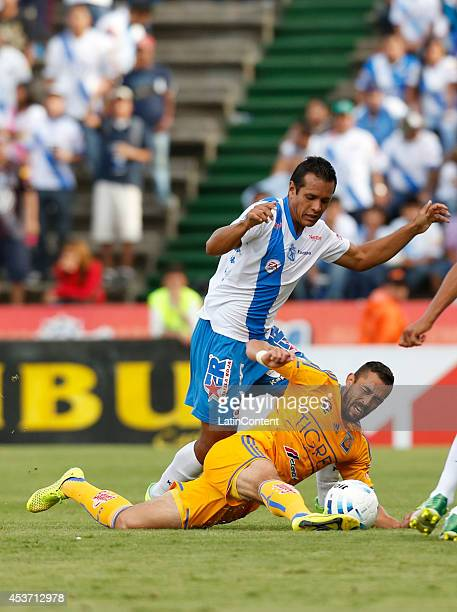 Hercules Gomez of Tigres UANL fights for the ball with Mario de Luna of Puebla during a match between Puebla and Tigres UANL as a part of 5th round...
