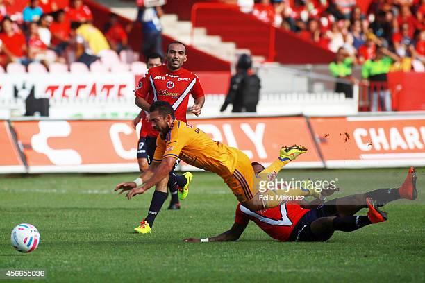 Hercules Gomez of Tigres UANL is fouled during a match between Veracruz and Tigres UANL as part of 12th round Apertura 2014 Liga MX at Luis 'Pirata'...
