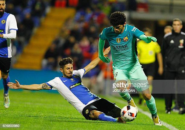 Hercules' midfielder Juanma Espinosa vies with Barcelona's midfielder Carles Alena during the Spanish Copa del Rey round of 32 first leg football...