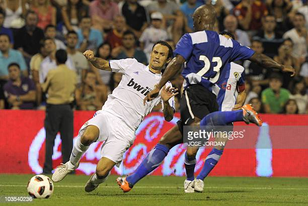 Hercules' Noe Pamarot from France vies for the ball with Real Madrid's Alvaro Arbeloa during their friendly football match at Rico Perez stadium in...