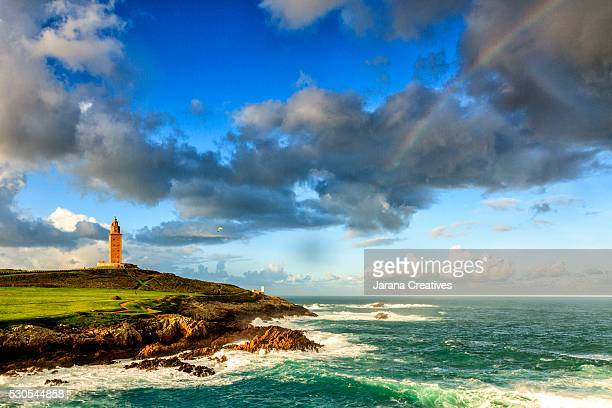 hercules tower and rainbow in a coruña - a coruña stockfoto's en -beelden
