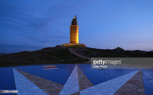 hercules tower at sunset a coruña, spain. - tower stock pictures, royalty-free photos & images