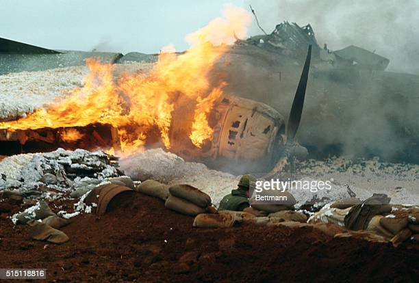 Hercules transport plane is engulfed in flames after it was hit by communist fire during takeoff from the air strip One passenger was injured and...
