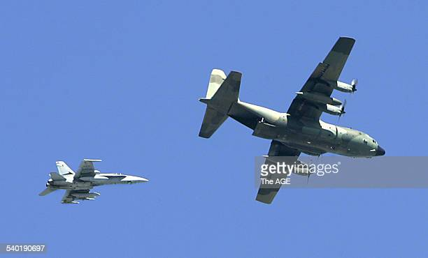 Hercules with FA18 on its tail over the Melborne city sky 19 March 2007 THE AGE NEWS Picture by MICHAEL CLAYTONJONES