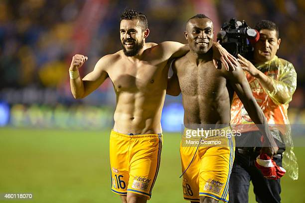 Herculez Gomez and Joffre Guerron of Tigres celebrate at the end of a semifinal second leg match between Tigres UANL and Toluca as part of the...