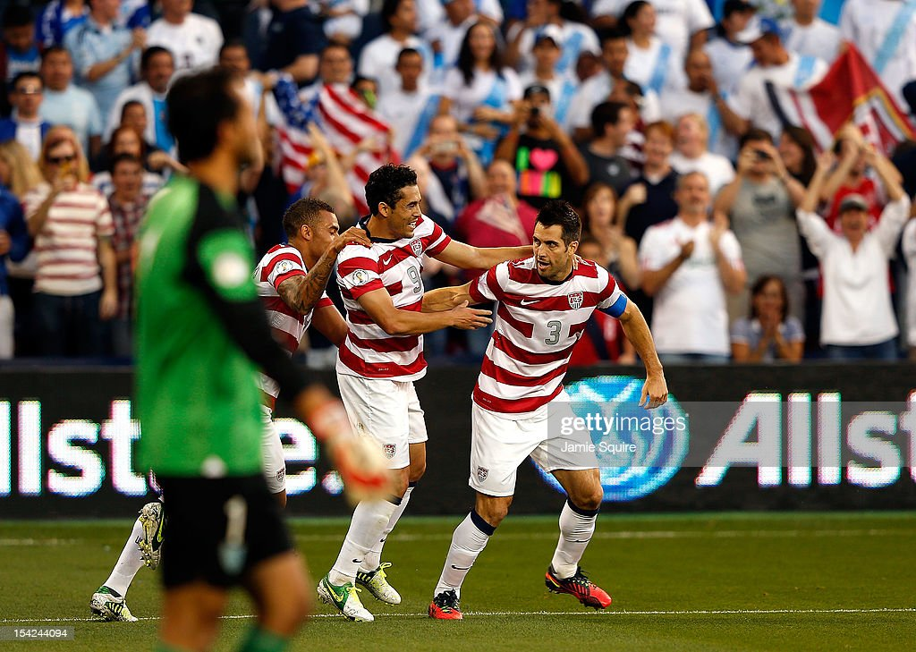Herculez Gomez #9, Danny Williams #14, and Carlos Bocanegra #3 of the USA celebrate after Bocanegra scored a goal during the first half of the World Cup Qualifying match against Guatemala at LiveStrong Sporting Park on October 16, 2012 in Kansas City, Kansas.