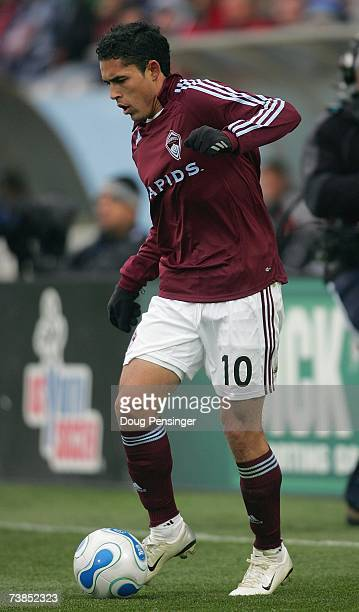 Herculez Gomez of Colorado Rapids controls the ball during MLS match action against DC United in the Inaugural Game at Dick's Sporting Goods Park on...
