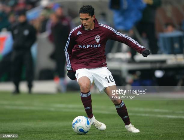 Herculez Gomez of Colorado Rapids looks to make a play with the ball during MLS match action against DC United in the Inaugural Game at Dick's...