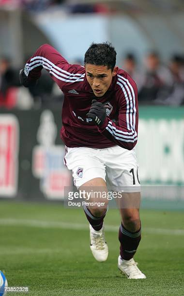 Herculez Gomez of Colorado Rapids moves to the ball during MLS match action against DC United in the Inaugural Game at Dick's Sporting Goods Park on...