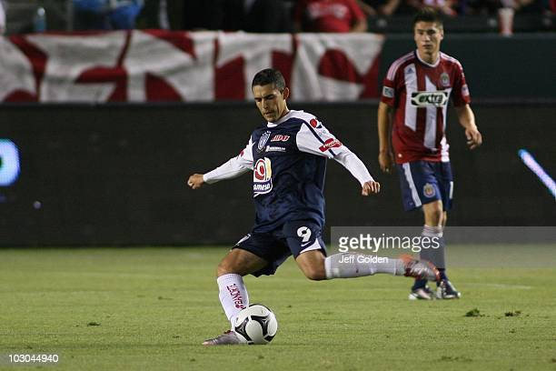 Herculez Gomez of Pachuca kicks the ball against Chivas USA during the SuperLiga 2010 match on July 21 2010 at the Home Depot Center in Carson...