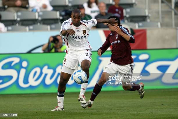 Herculez Gomez of the Colorado Rapids fights for the ball against Eddie Pope of Real relay on May 10, 2007 at Dick's Sporting Goods Park in Commerce...