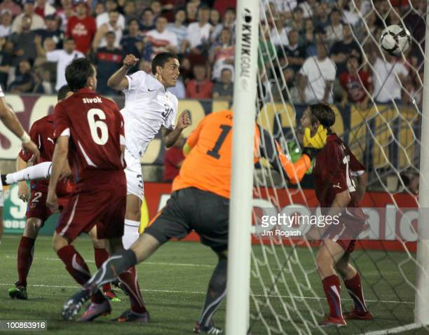 Herculez Gomez of the United States scores a goal against goalie Petr Cech of the Czech Republic at Rentschler Field on May 25 2010 in East Hartford...