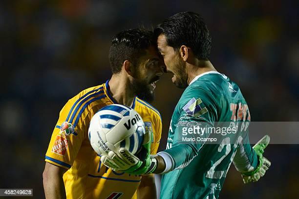 Herculez Gomez of Tigres argues with Edgar Hernandez goalkeeper of Queretaro during a match between Tigres UANL v Queretaro as part of 15th round...