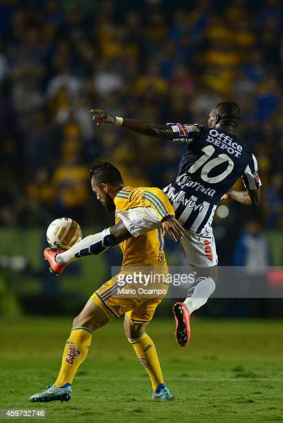 Herculez Gomez of Tigres fights for the ball with Walter Ayovi of Pachuca during a quarterfinal second leg match between Tigres UANL and Pachuca as...