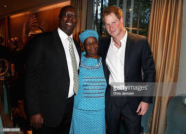 Herd Boy Coordinator Mokhachane Lerotholi Malineo Motsephe and Prince Harry attend the Sentebale Summer Party at the Dorchester Hotel on May 7 2014...