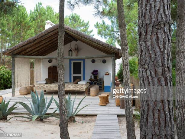 Herdade da Comporta refers to an area of 12500 hectares the old restored fishermen's huts of the former owner Espirito Santo familyThe Parisian...