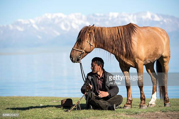 A herdsman sits near Sayram Lake in Xinjiang Uyghur Autonomous Region northhwest China on 4th June 2015