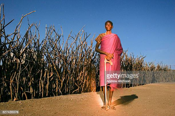 A herdsman stands watches and waits for his goats under the moonlight outside the village of Kaikor in Turkana Northern Kenya | Location Kaikor...