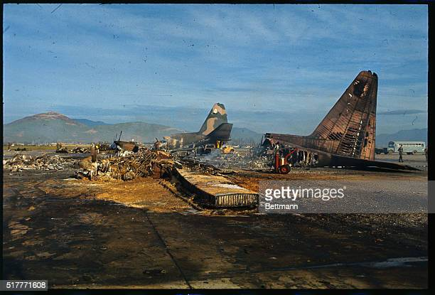 Here are general views of wrecked C 130s on July 25th following a Viet Cong rocket attack of Danang air base