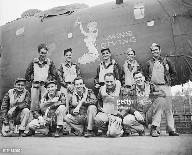 Here are members of the B24 Liberator Bomber Miss Giving credited with making the longest flight mission from Australia while on photographic...