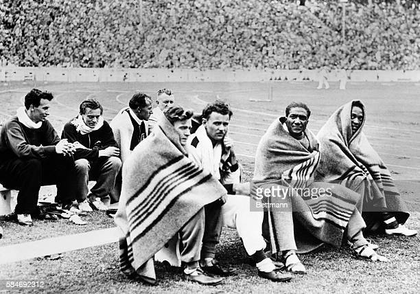 Here are some of the contestants in the 100meters dash at the Olympic Games in Berlin swathed in blankets after running their race Left to right are...