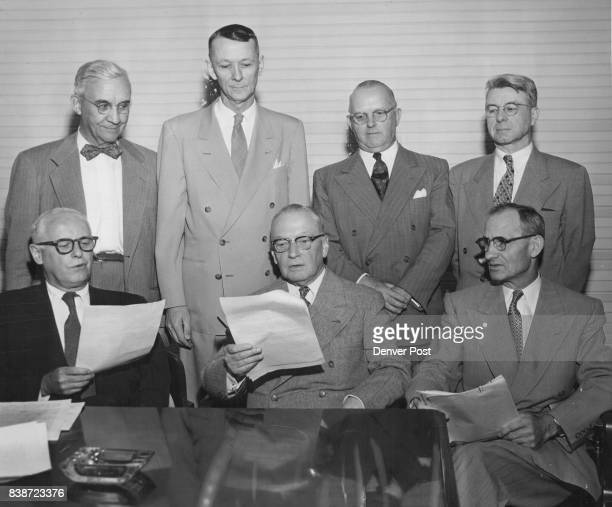 Here are some of the railroad executives meeting in Denver to study problems of lines operat­ing in the west From left are Bert Vickery Burlington A...