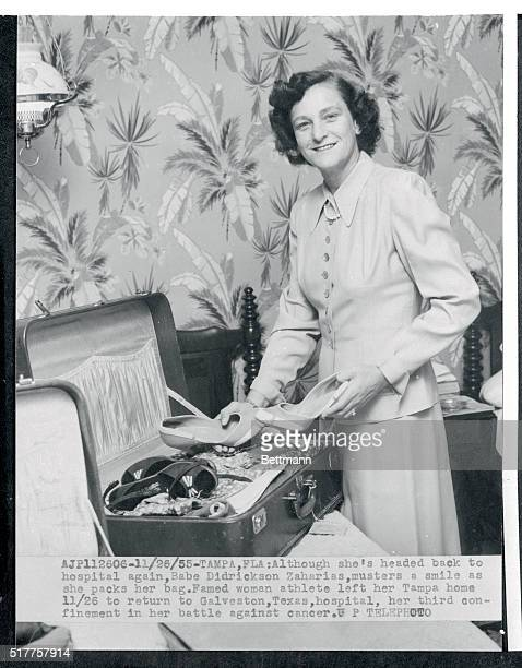 Here Babe Zaharias musters a big smile as she packs her bag for another trip to the hospital in November 1955 Leaving her Tampa home to return to...