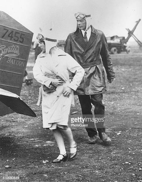 Here Charles A Lindbergh and Mrs Anne Morrow Lindbergh prepare to take off from Roosevelt Field, LI for an inspection flight tour, New York, 1929....