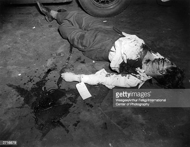 Here he is as he was left in the gutter in a pool of his own blood The body of a young man lies in a New York street with a DOA tag tied to his arm...