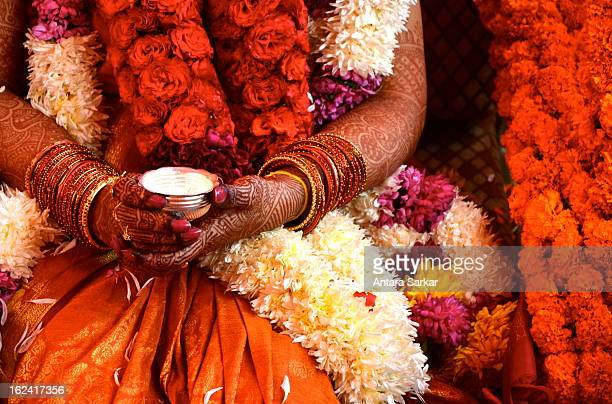 CONTENT] Here is a Hindu Tamilian bride on her wedding day The henna the garlands and the bangles are all very important elements of Indian weddings