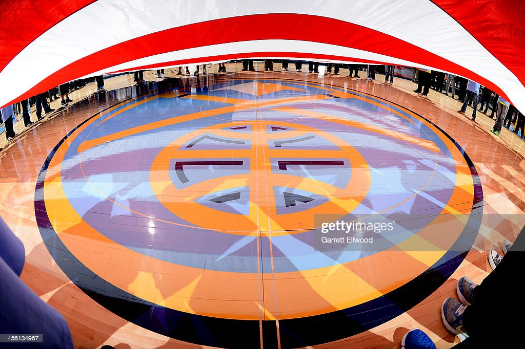 Here is a photograph of the Denver Nuggets logo prior to the game against the Utah Jazz on December 13, 2013 at the Pepsi Center in Denver, Colorado.