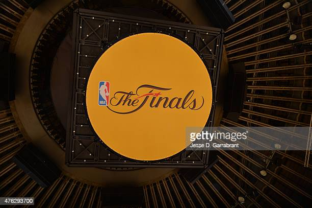 Here is a photograph of the NBA Finals logo that hangs below the bottom of the big screen Where the Cleveland Cavaliers against the Golden State...