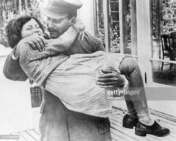 Here is a rare photo of Marshal Josef Stalin holding his daughter Svetlana The photo was made in 1937 at Stalin's country house in the suburbs of...