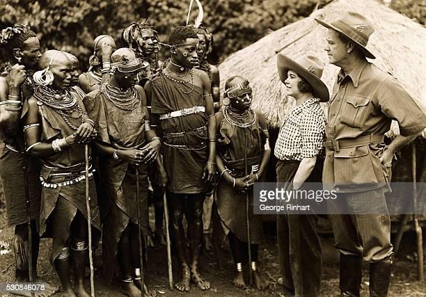 Here is an European man and woman with a group of Kikuyu near Narobi Kenya