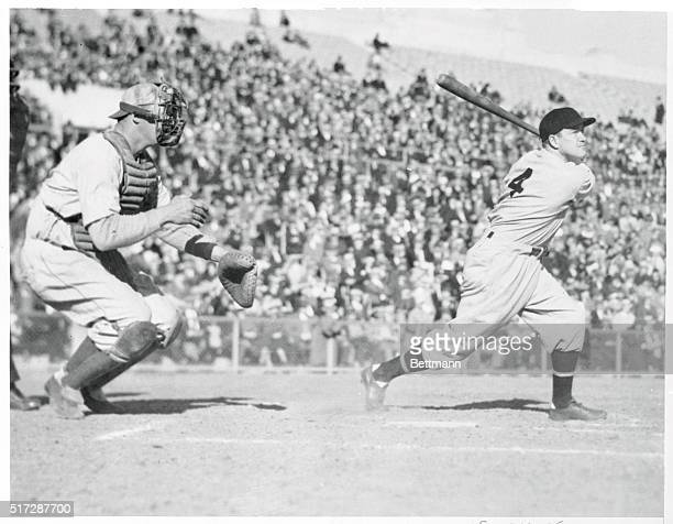 Here is Joe Cronin hoisting a long one when the willow met the sphere in the benefit game played recently at San Francisco, California. Ernie...